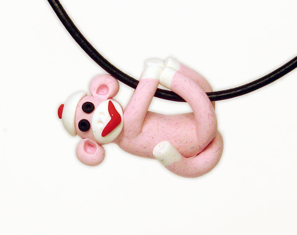 Pink Sock Monkey Pendant Swinging from all fours handmade in Polymer Clay